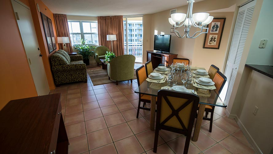 A Suite guest living room and dining room area, Vacation Village at Bonaventure