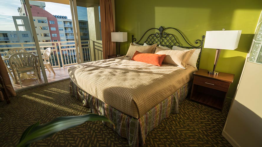 A Suite guest master bedroom with sliding door access to balcony, Vacation Village at Bonaventure