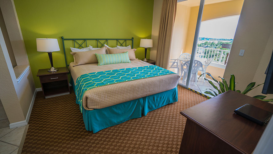 A Suite bedroom with sliding door access to balcony, Vacation Village at Weston