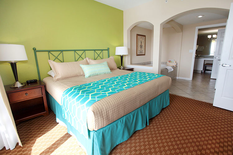A Suite bedroom with jetted tub, Vacation Village at Weston